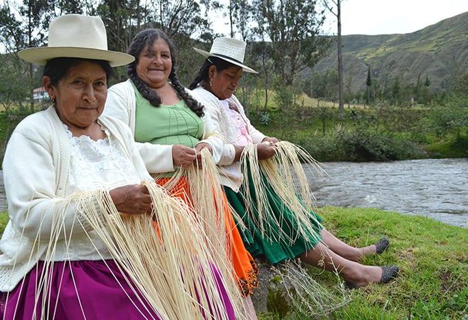 Pachacuti panama hat weavers by river ecuador