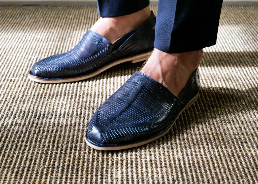 Woven detail of navy blue leather loafer