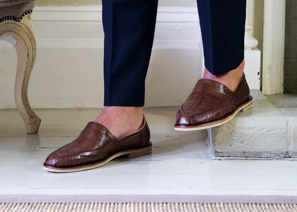 Man wearing dark brown leather loafer