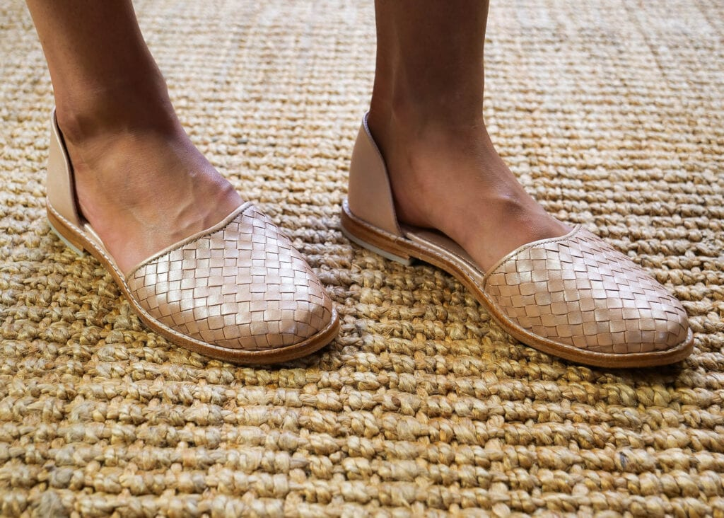All occasions leather, rose gold shoe worn by a lady