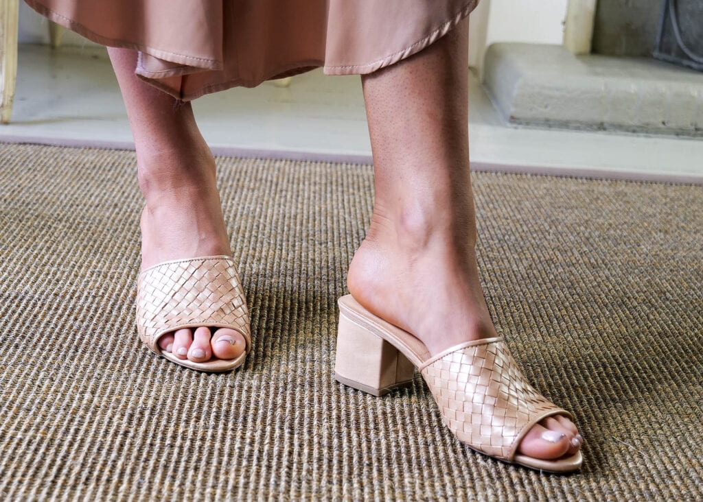 Women in comfy rose gold mules