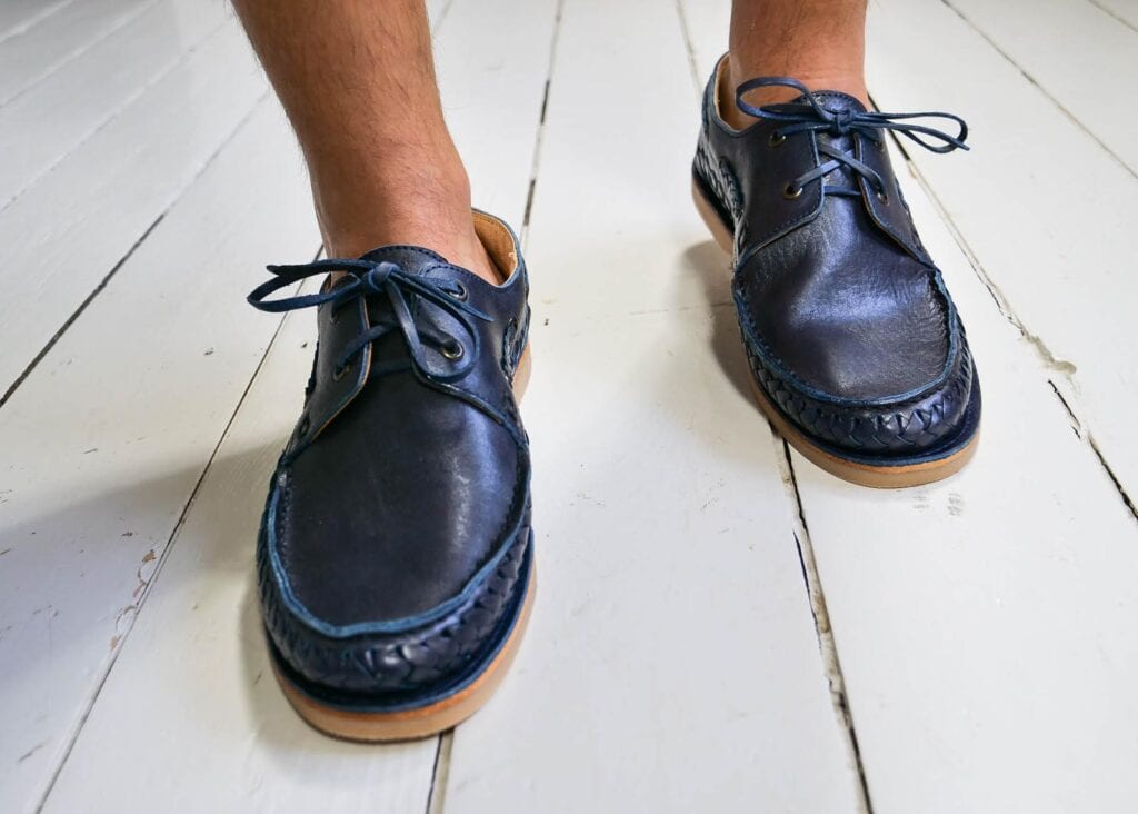 Leather laces on men's classic boat shoe in navy blue