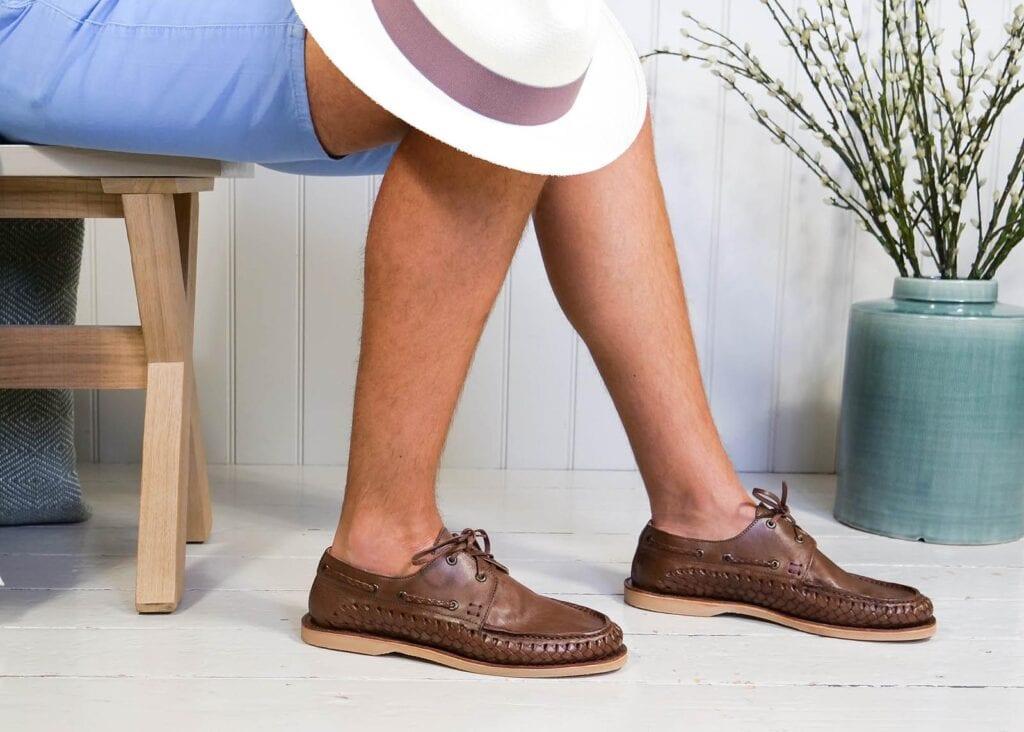 Man wears brown boat shoe