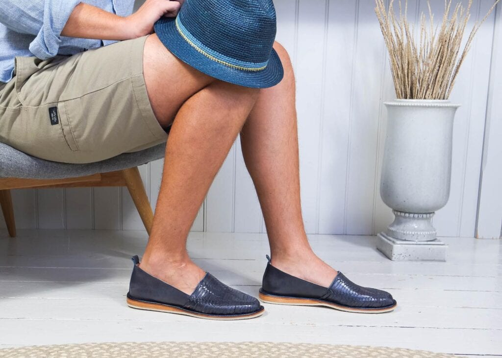 Man wears navy slip-on loafer shoe