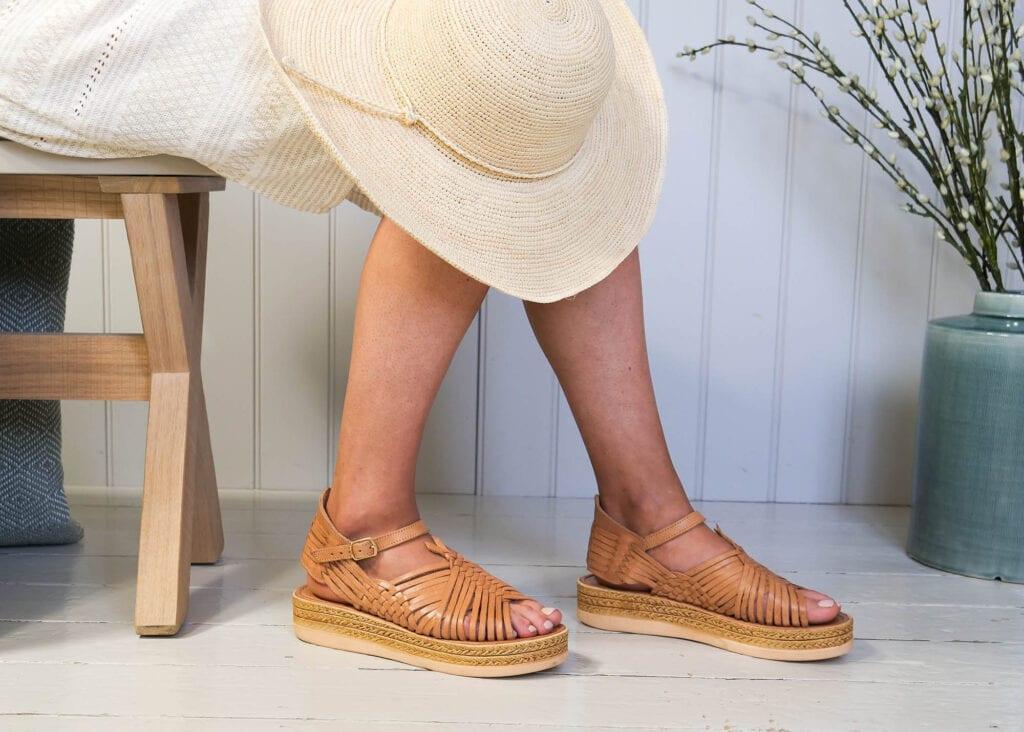 Women wear platform sandal in tan leather