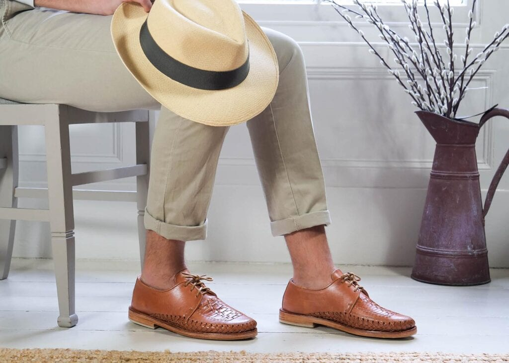 Man wears lace up leather dress shoe with chinos showing a smart casual look