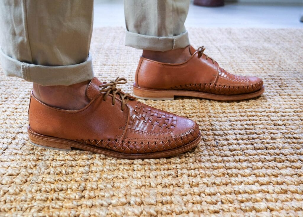 Hand woven pattern on the front of a classic pair of men's dress shoes with leather lace