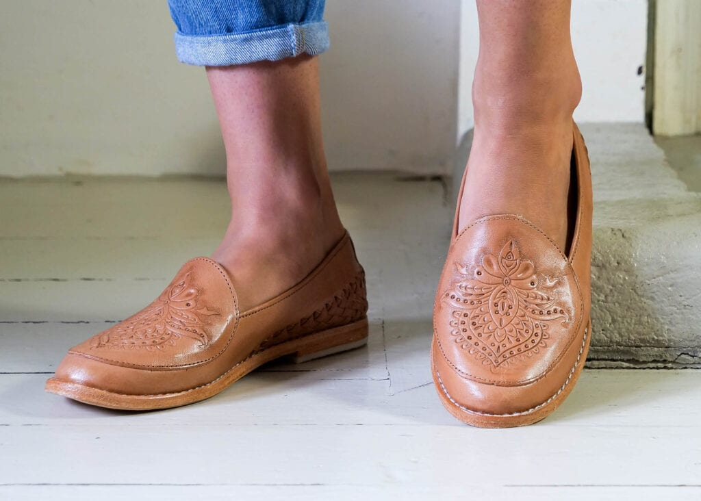 Detailed shot of hand embossed pattern on women's classic tan loafer